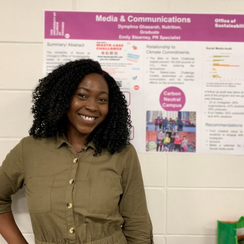 2019 SIP intern Dymphna Ghasarah in front of her internship poster