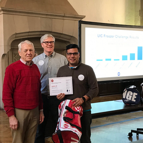Winner of the 2019 freezer challenge, Nick Perez, with Professor George Crabtree and Registrar Robert Dixon