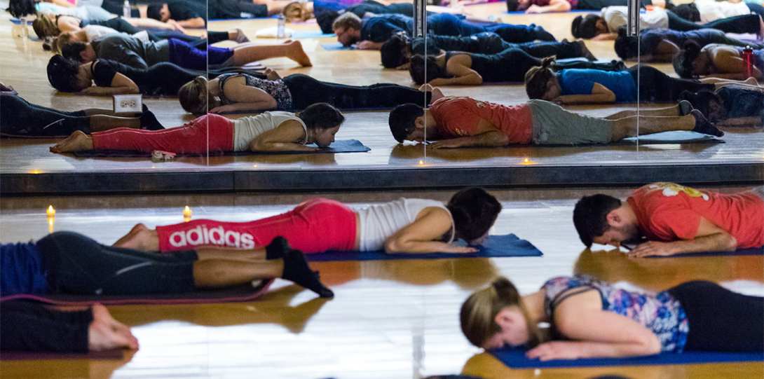 Students lying down during a yoga class